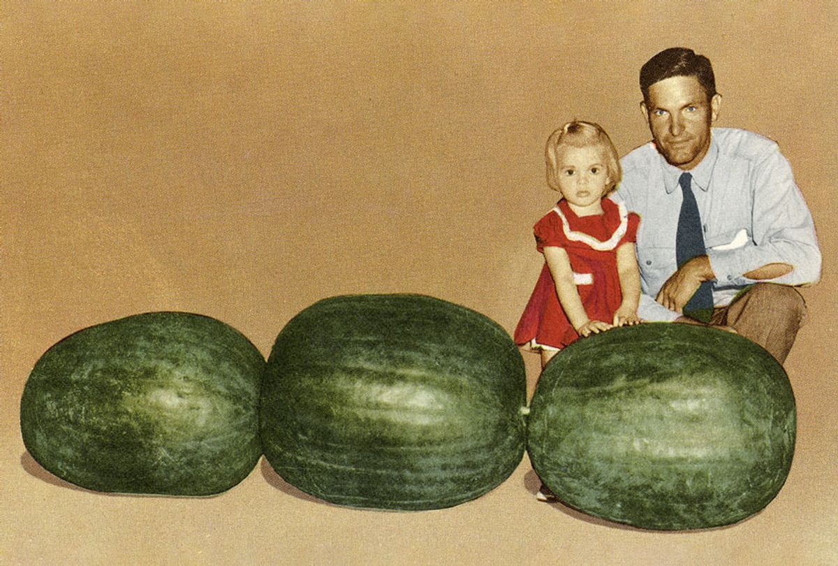 Man and Child with Large Watermelons. (Found Image Holdings/Getty Images)