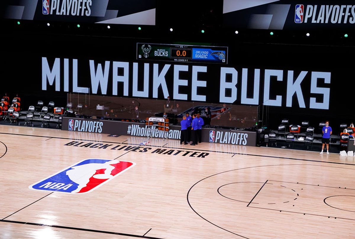 Referees huddle on an empty court at game time of a scheduled game between the Milwaukee Bucks and the Orlando Magic for Game Five of the Eastern Conference First Round during the 2020 NBA Playoffs at AdventHealth Arena at ESPN Wide World Of Sports Complex on August 26, 2020 in Lake Buena Vista, Florida. (Kevin C. Cox/Getty Images)