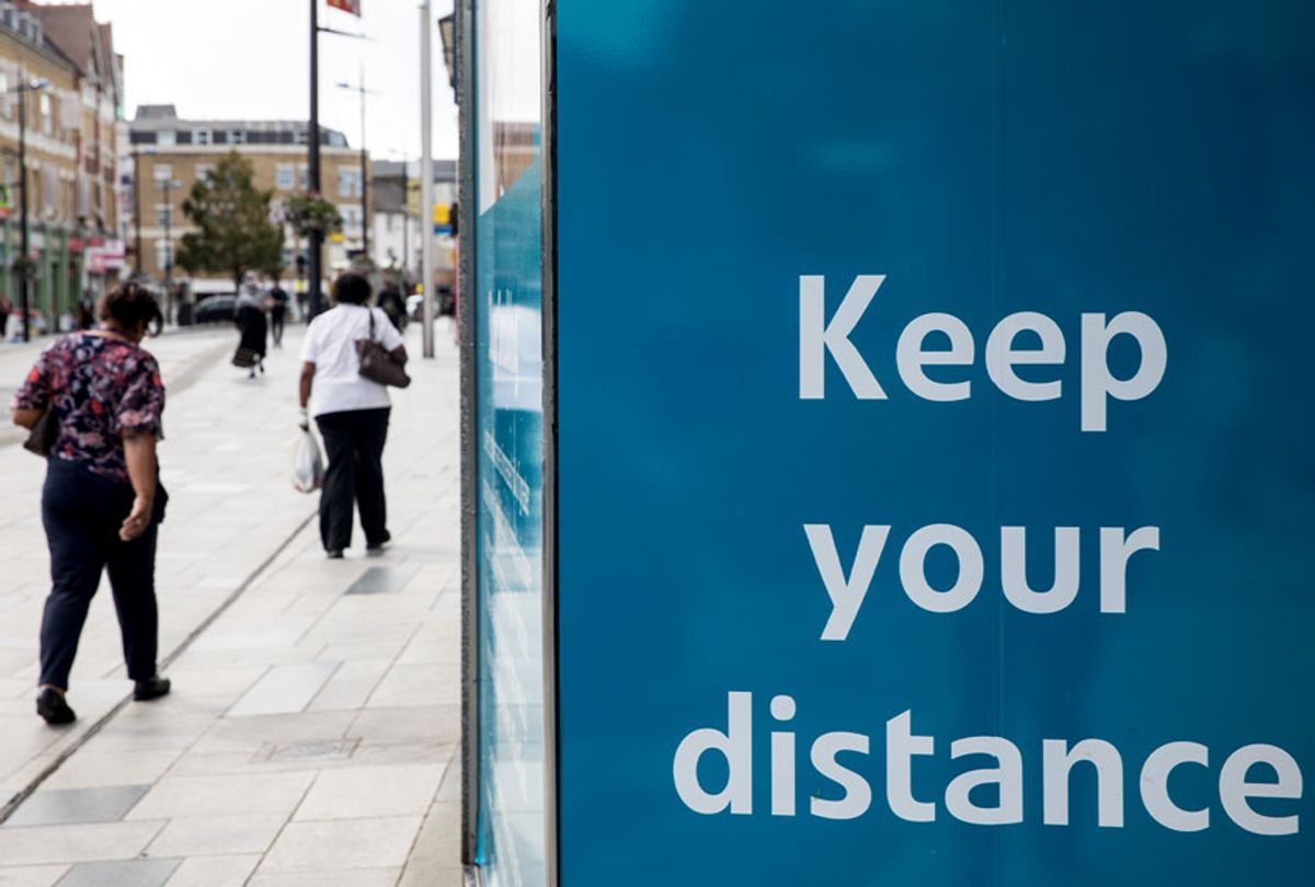 Members of the public walk past a COVID-19 social distancing display on 21st August 2020 in Slough, United Kingdom. Slough has been listed by Public Health England (PHE) and the Department for Health and Social Care (DHSC) as an area of concern for COVID-19 following a rise in positive coronavirus cases over the last two weeks. (Mark Kerrison/In Pictures via Getty Images)