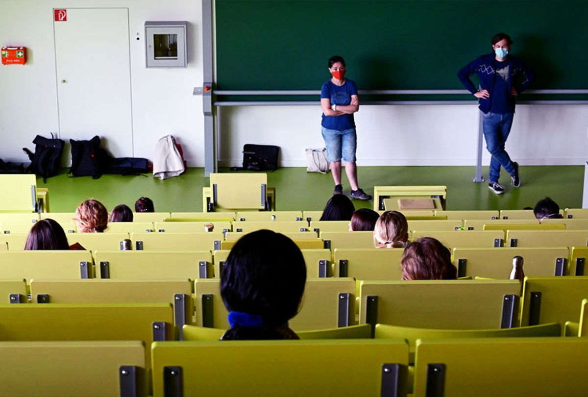 Students of economics and business studies sit in a lecture hall, observing the distance rule, and wait for the exam to begin (Getty Images)