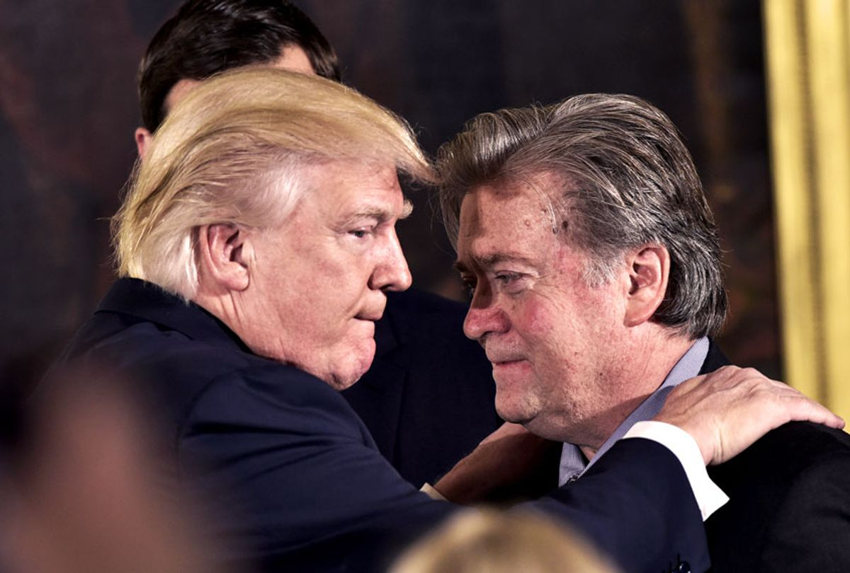US President Donald Trump (L) congratulates Senior Counselor to the President Stephen Bannon during the swearing-in of senior staff in the East Room of the White House on January 22, 2017 in Washington, DC. (MANDEL NGAN/AFP via Getty Images)