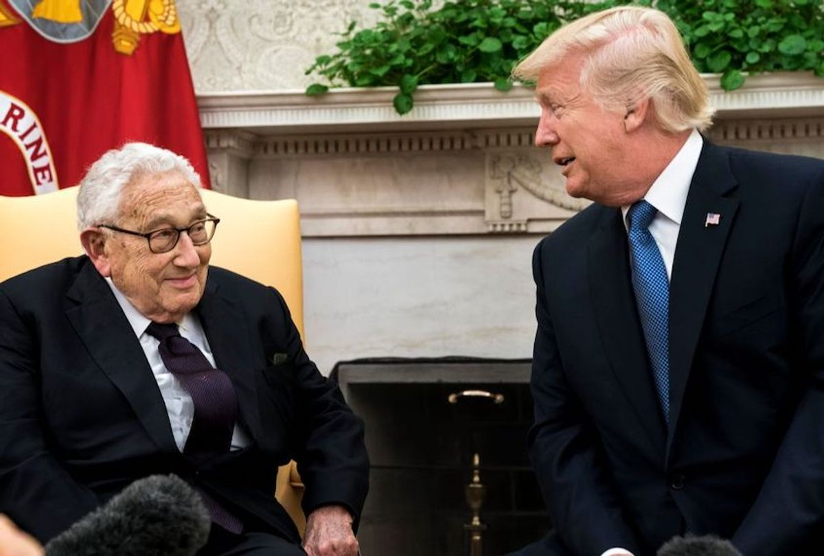President Donald Trump sits with Dr. Henry Kissinger, while speaking to gathered press, in the Oval Office at the White House in Washington, DC Tuesday October 10, 2017. (Melina Mara/The Washington Post via Getty Images)