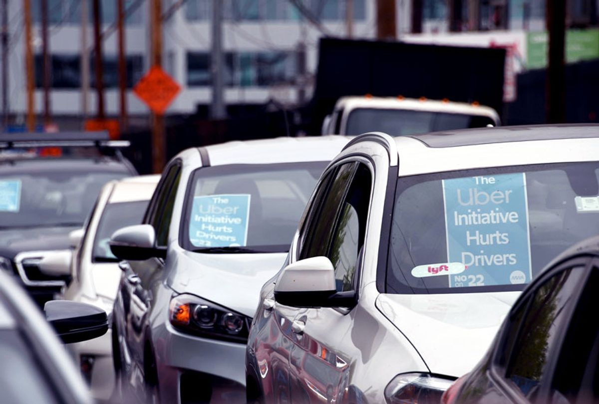 Rideshare drivers demonstrate against rideshare companies Uber and Lyft during a car caravan protest on August 6, 2020 in Los Angeles. (ROBYN BECK/AFP via Getty Images)