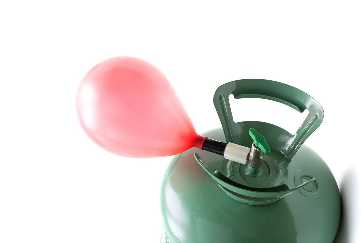 Helium gas cylinder and balloon (Getty Images)