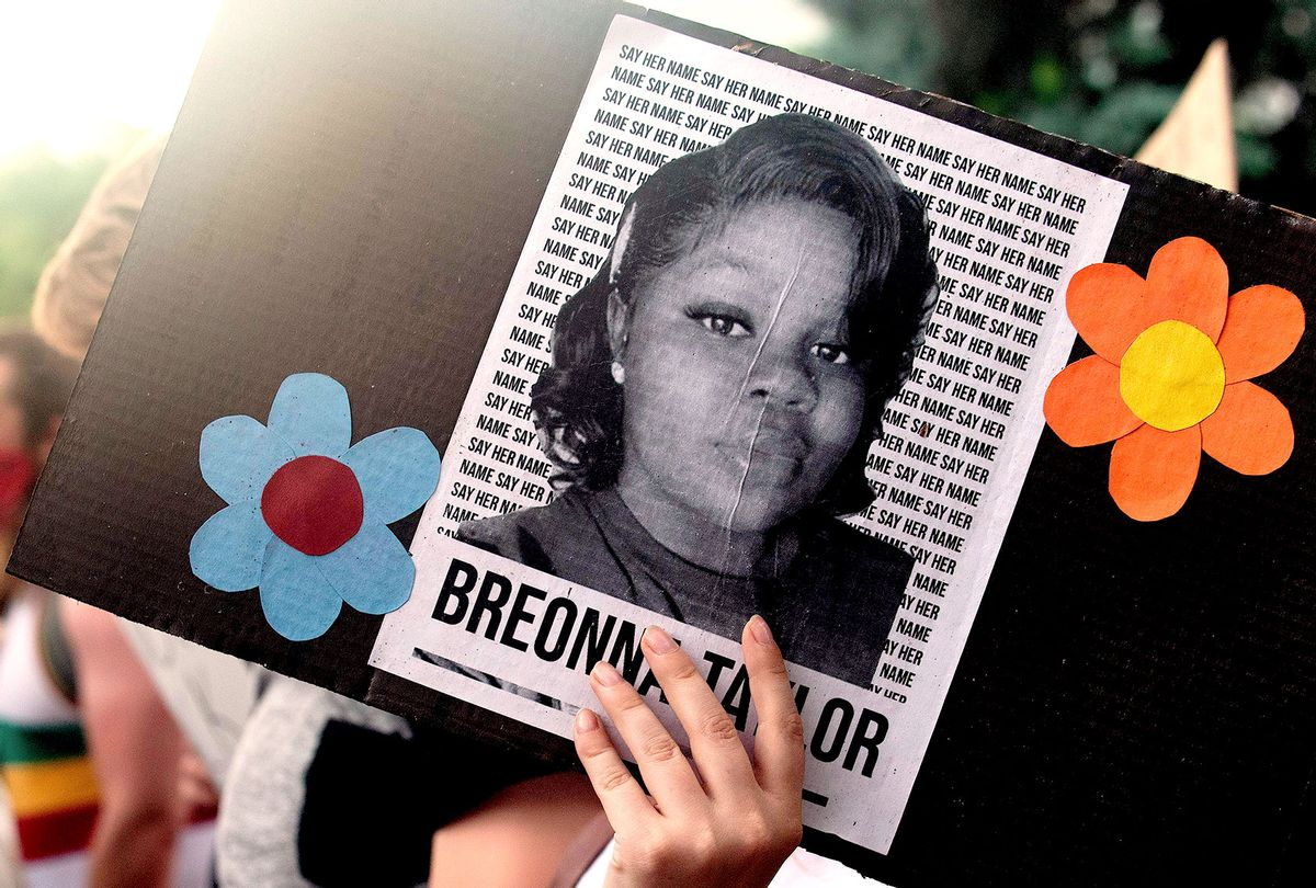 A demonstrator holds a sign with the image of Breonna Taylor, a black woman who was fatally shot by Louisville Metro Police Department officers, during a protest against the death George Floyd in Minneapolis, in Denver, Colorado on June 3, 2020. (JASON CONNOLLY/AFP via Getty Images)