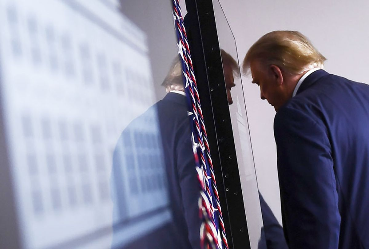 US President Donald Trump leaves after speaking to the press in the Brady Briefing Room of the White House in Washington, DC, on August 3, 2020. (BRENDAN SMIALOWSKI/AFP via Getty Images)
