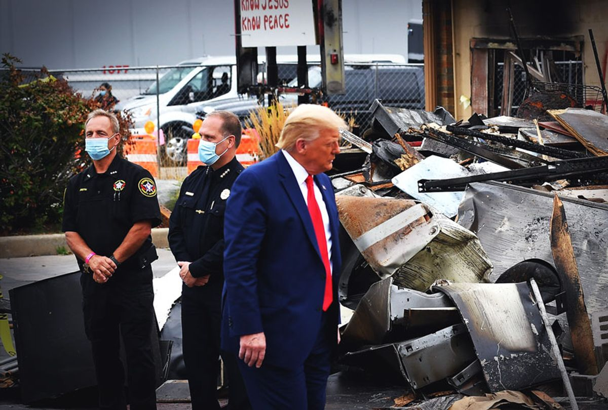 US President Donald Trump tours an area affected by civil unrest in Kenosha, Wisconsin on September 1, 2020. - Trump visited Kenosha, the Wisconsin city at the center of a raging US debate over racism, despite pleas to stay away and claims he is dangerously fanning tensions as a reelection ploy. (MANDEL NGAN/AFP via Getty Images)