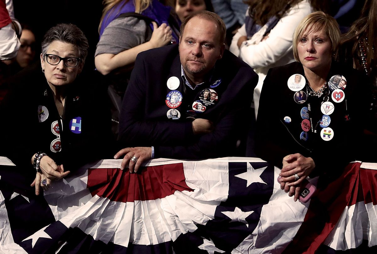 People watch the voting results at Democratic presidential nominee former Secretary of State Hillary Clinton's election night event at the Jacob K. Javits Convention Center November 9, 2016 in New York City. (Elsa/Getty Images)