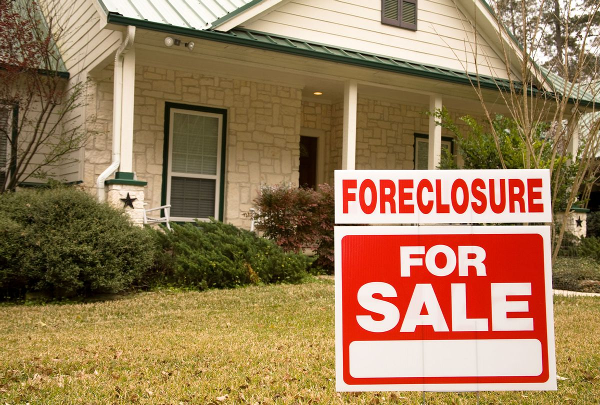 Foreclosure for sale sign in front of house  (Getty Images)