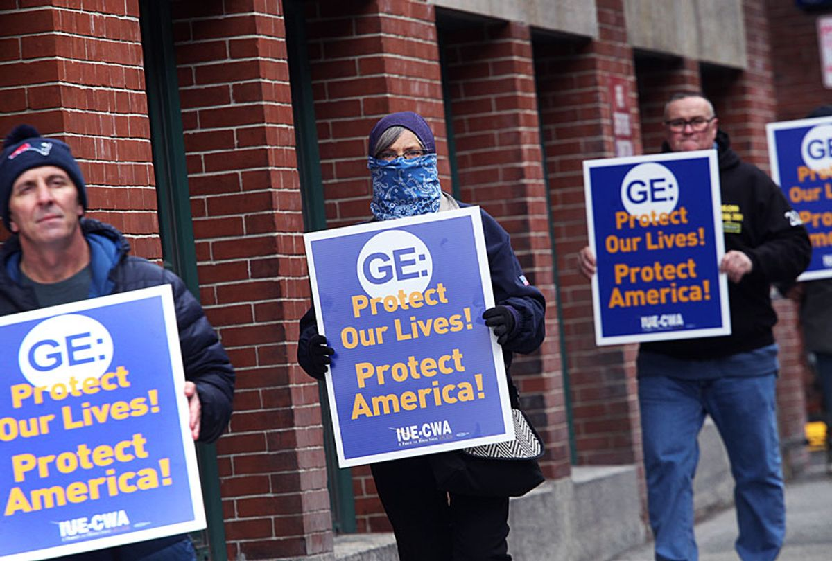 General Electric workers hold a protest on Necco Street in Boston, MA out of concerns for their safety on March 30, 2020. The machinists, hand-tool operators, and inspectors who build jet and helicopter engines for the US military were concerned that their shared workstations werent being sanitized between around-the-clock shifts while the highly contagious coronavirus ravages the country, according to their union. (Suzanne Kreiter/The Boston Globe via Getty Images)