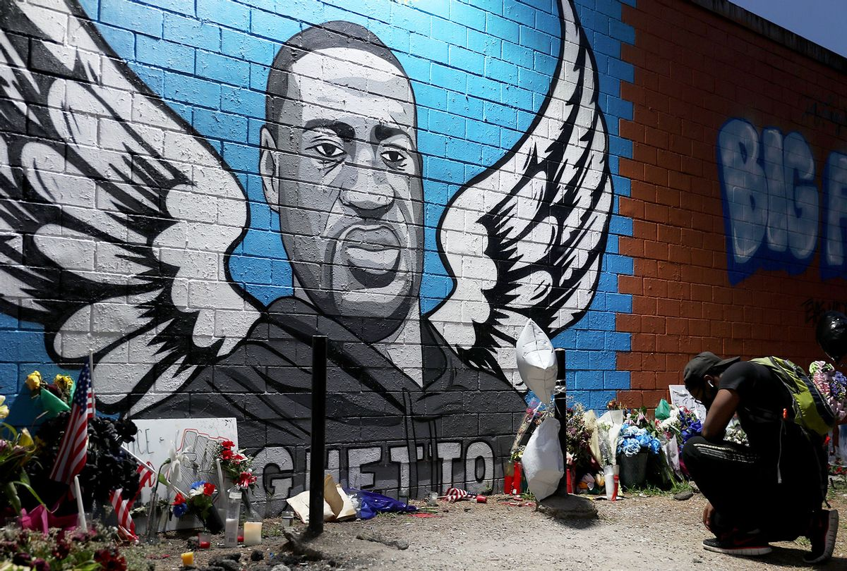 A memorial and mural that honors George Floyd at the Scott Food Mart corner store in Houston's Third Ward where Mr. Floyd grew up on June 8, 2020 in Houston, Texas (Joe Raedle/Getty Images)
