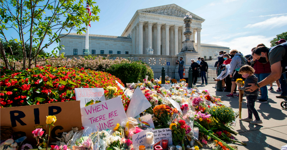 People place flowers outside the U.S. Supreme Court in memory of Justice Ruth Bader Ginsburg. Ginsburg died on Sept. 18, opening a crucial vacancy on the high court, setting off a pitched political battle at the peak of the presidential campaign (Jose Luis Magana/AFP via Getty Images)