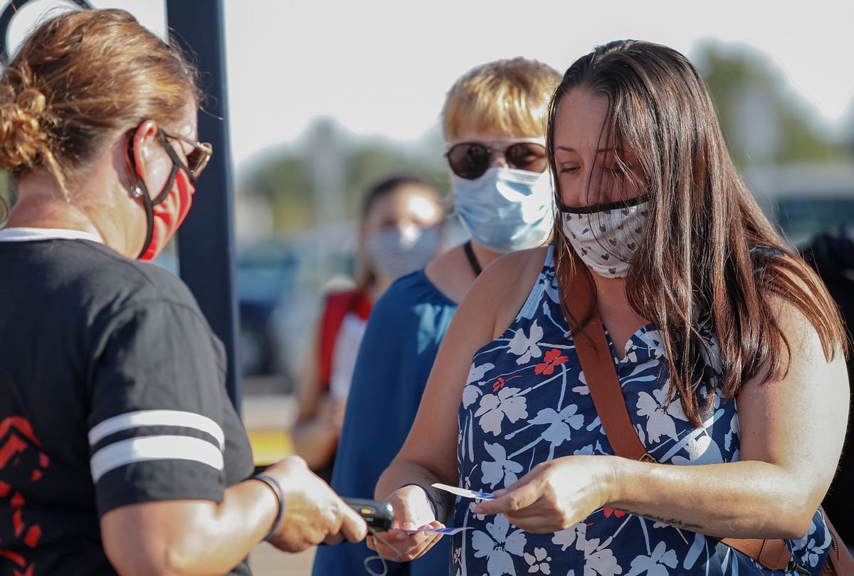 Fans wearing masks enter the game between the Lafayette Jefferson Broncos and West Lafayette Red Devils at Lafayette Jefferson High School on August 21, 2020 in Lafayette, Indiana. (Michael Hickey/Getty Images)