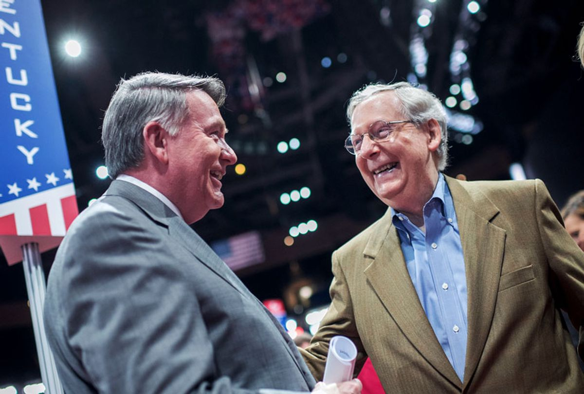 Senate Majority Leader Mitch McConnell, R-Ky., and Mike Duncan, former chairman of the Republican National Committee, talk on the floor of the Quicken Loans Arena in Cleveland, Ohio, a day before the start of the Republican National Convention, July 17, 2016. (Tom Williams/CQ Roll Call)