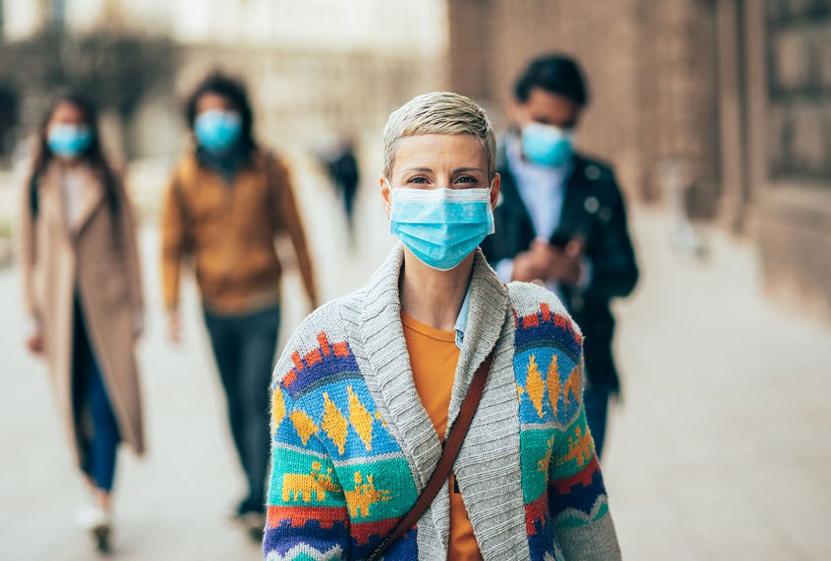 Woman with face protective mask (Getty Images)