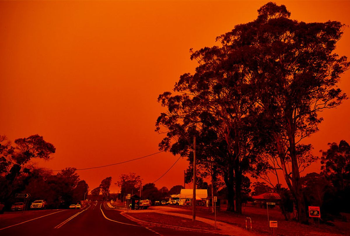 The sky turns red over the town on January 04, 2020 in Bodalla, Australia. A state of emergency has been declared across NSW with dangerous fire conditions forecast for Saturday, as more than 140 bushfires continue to burn. (Brett Hemmings/Getty Images)