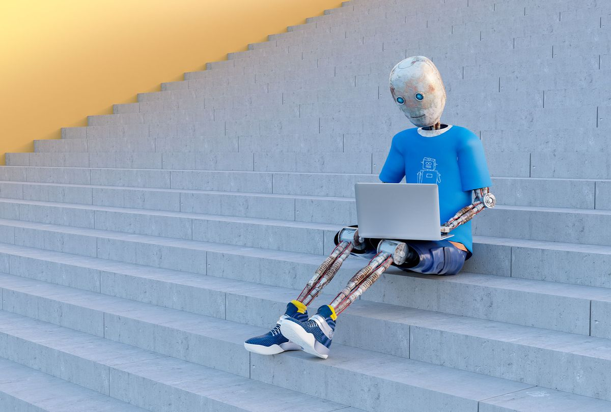 Robot sitting on stairs using laptop (Getty Images)