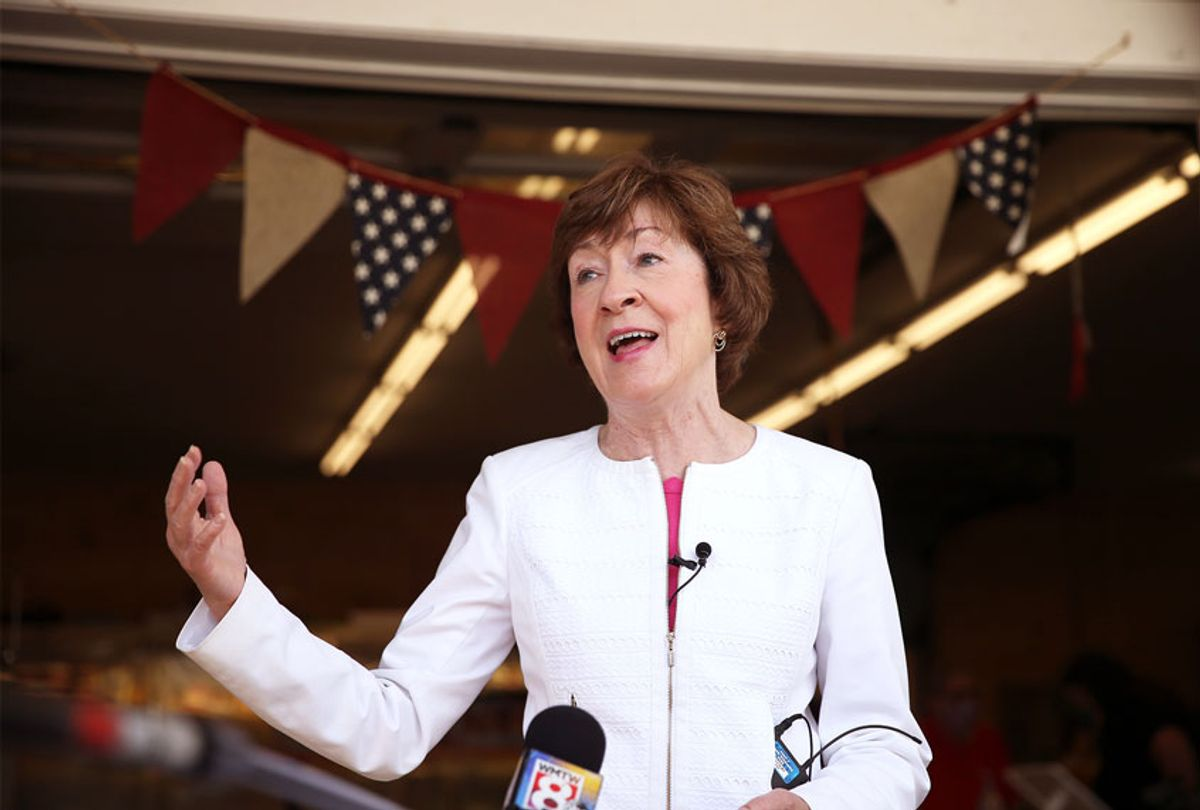 U.S. Sen. Susan Collins talks to reporters during a campaign stop at Blackie's Farm Fresh Produce on Thursday. (Ben McCanna/Portland Press Herald via Getty Images)