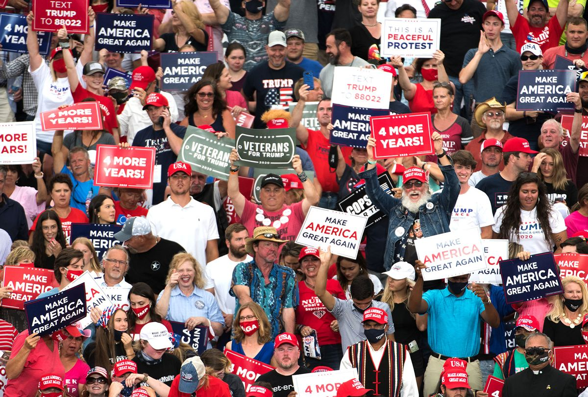People cheer for President Donald Trump during a campaign rally at Smith Reynolds Airport on September 8, 2020 in Winston Salem, North Carolina. The president also made a campaign stop in South Florida on Tuesday. (Sean Rayford/Getty Images)
