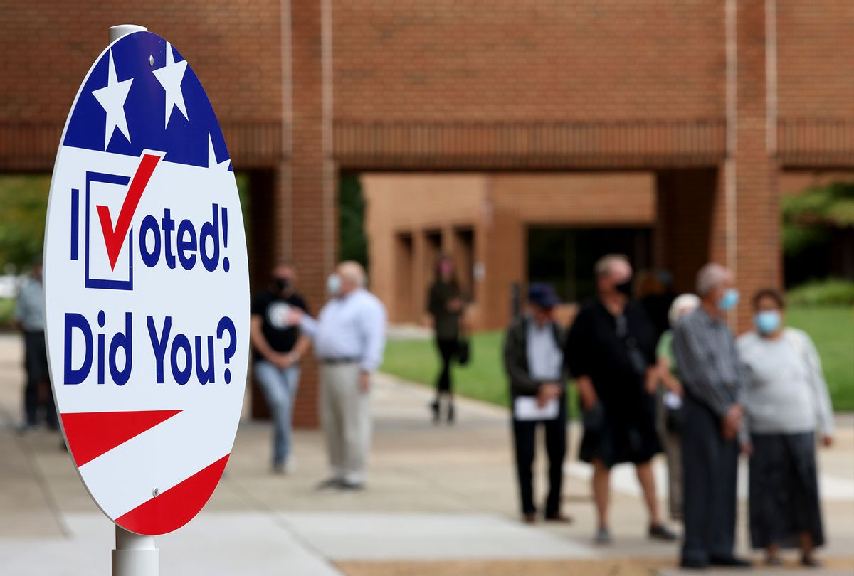 Voters in Virginia's 7th district wait in line to vote at the Henrico County Registrar's office September 18, 2020 in Henrico, Virginia. Today marks the beginning of Virginia's early voting program that continues through October 31. (Win McNamee/Getty Images)