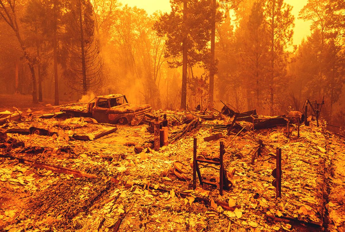 A burned residence smolders during the Bear fire, part of the North Lightning Complex fires, in unincorporated Butte County, California on September 09, 2020. (JOSH EDELSON/AFP via Getty Images)