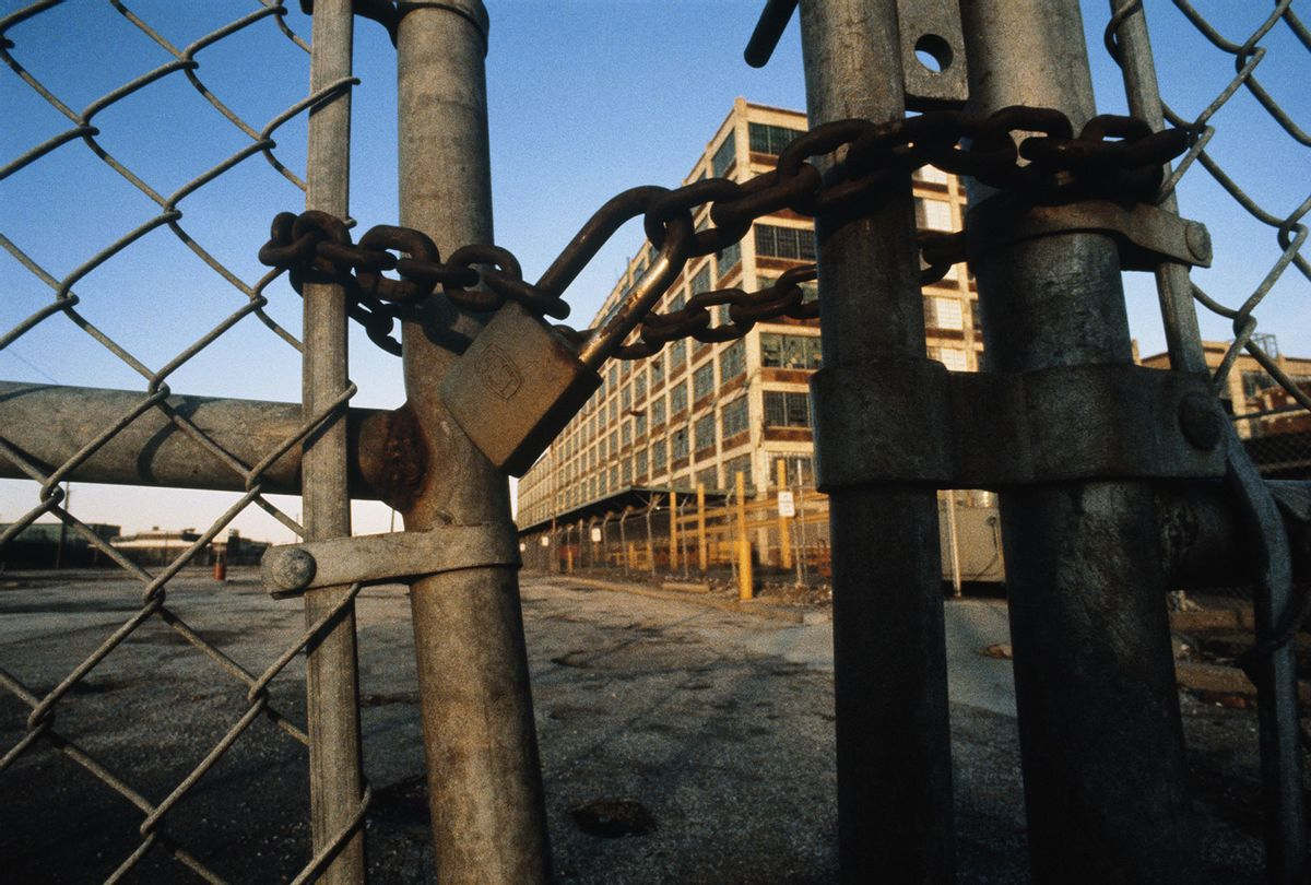 Rusty padlock and chain on gates of closed automobile plant (Getty Images)
