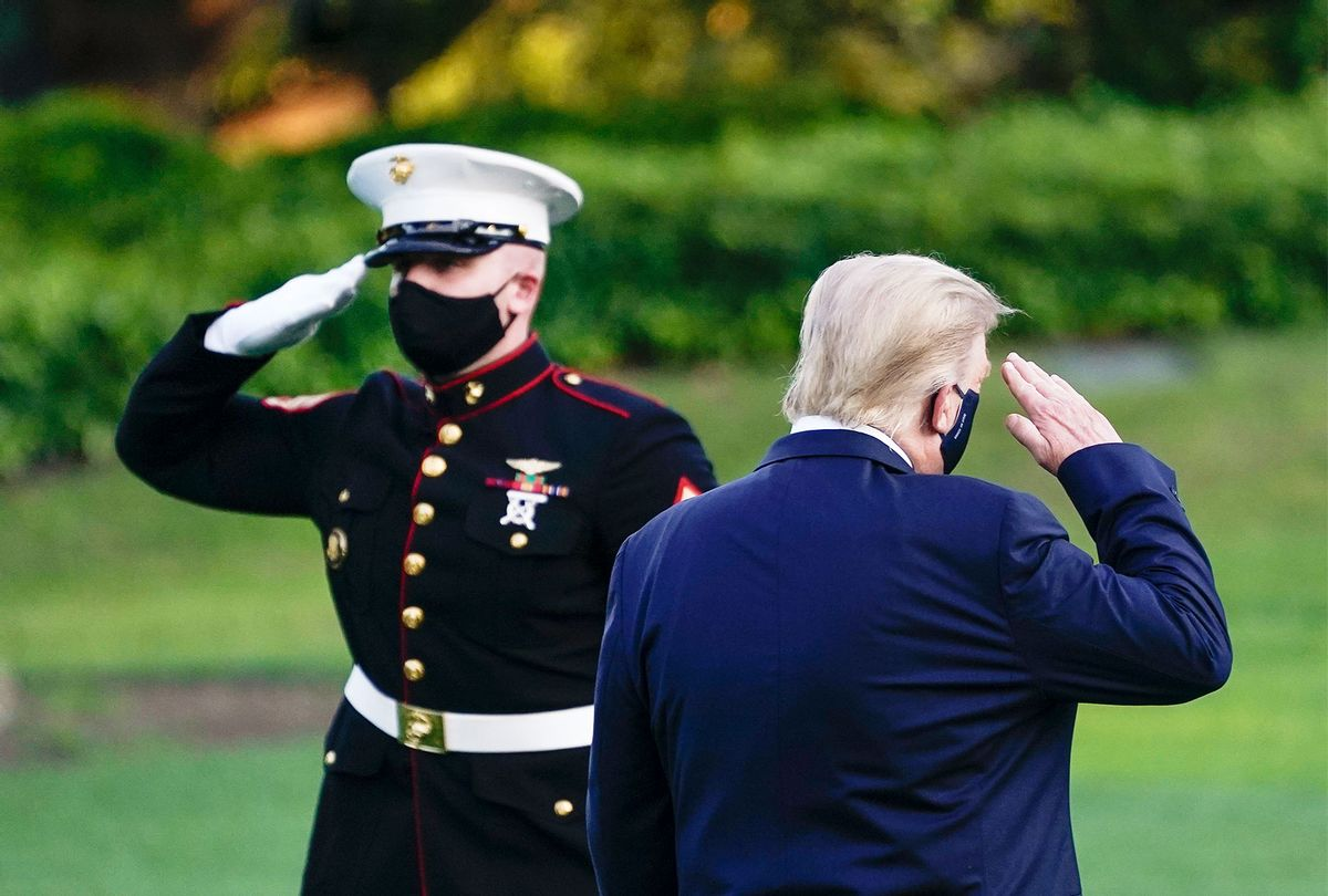 U.S. President Donald Trump salutes as he prepares to board Marine One for Walter Reed National Military Medical Center on the South Lawn of the White House on October 2, 2020 in Washington, DC. President Donald Trump and First Lady Melania Trump have both tested positive for coronavirus. (Drew Angerer/Getty Images)