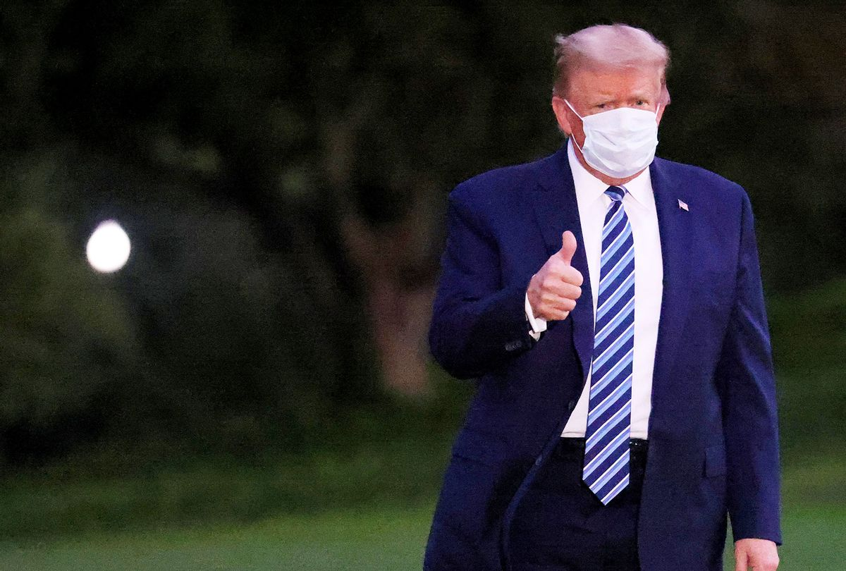 U.S. President Donald Trump gestures upon return to the White House from Walter Reed National Military Medical Center on October 05, 2020 in Washington, DC. Trump spent three days hospitalized for coronavirus. (Win McNamee/Getty Images)