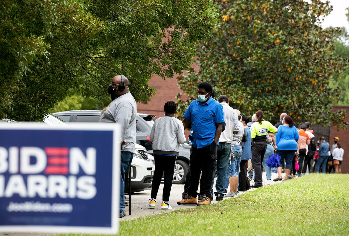 People stand in line on the first day of early voting for the general election at the C.T. Martin Natatorium and Recreation Center on October 12, 2020 in Atlanta, Georgia. Early voting in Georgia runs from October 12-30. (Jessica McGowan/Getty Images)