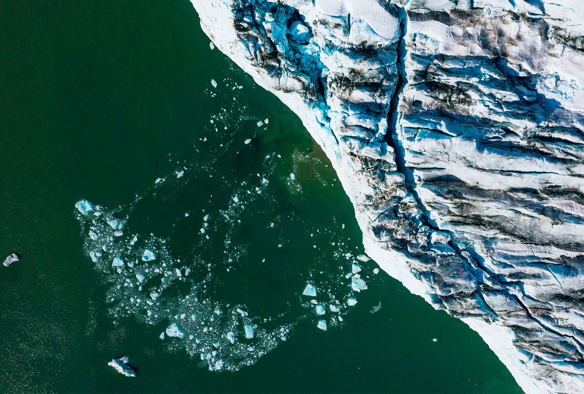 An aerial picture shows bergy bits and growlers floating in front of the Apusiajik glacier, near Kulusuk (aslo spelled Qulusuk), a settlement in the Sermersooq municipality located on the island of the same name on the southeastern shore of Greenland. (JONATHAN NACKSTRAND/AFP via Getty Images)