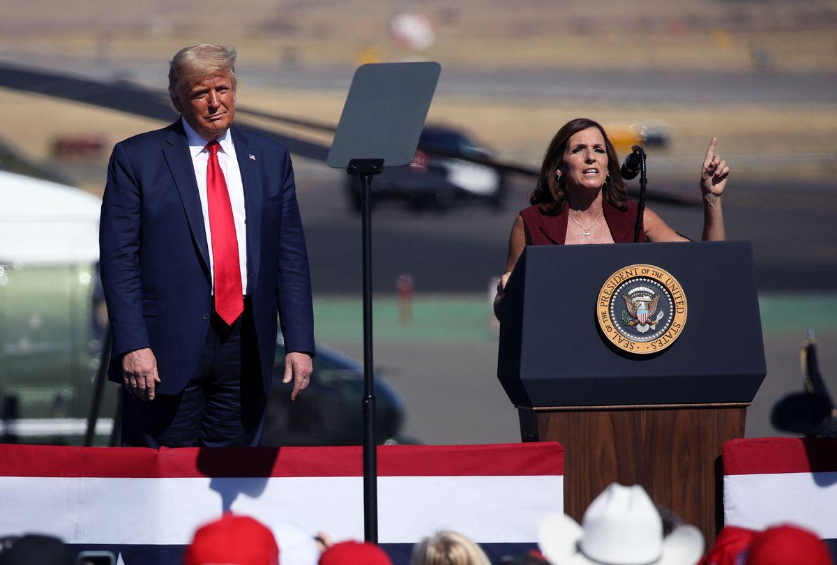 U.S. President Donald Trump watches as Senator Martha McSally (R-AZ) speaks at a Make America Great Again campaign rally on October 19, 2020 in Prescott, Arizona. (Caitlin O'Hara/Getty Images)