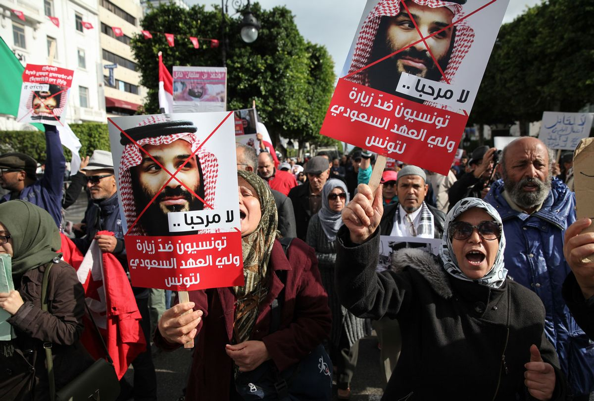 Protesters shout slogans while raising portraits of Mohammed bin Salman (Chedly Ben Ibrahim/NurPhoto via Getty Images)