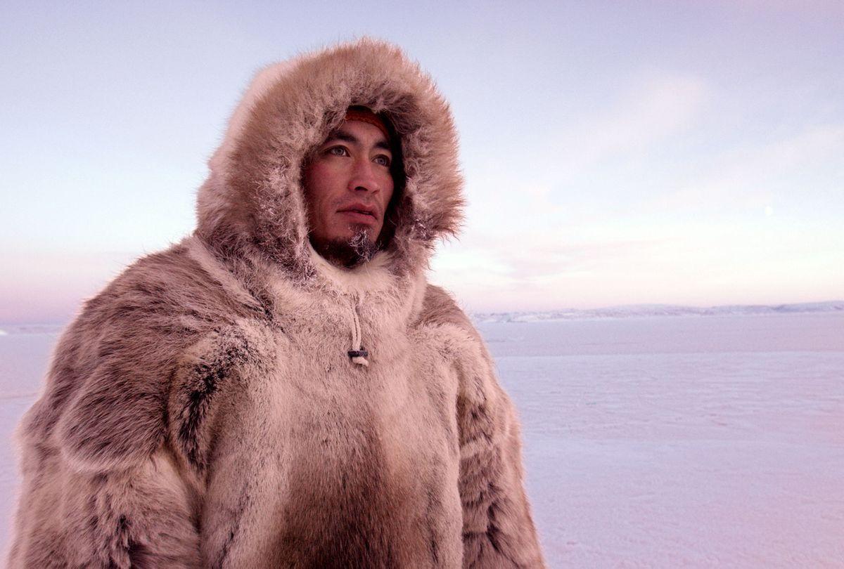 """The Last Ice"": Inuit hunter Aleqatsiaq Peary looks out over sea ice near Qaanaaq, Greenland (National Geographic Society/Neil Gelinas)"