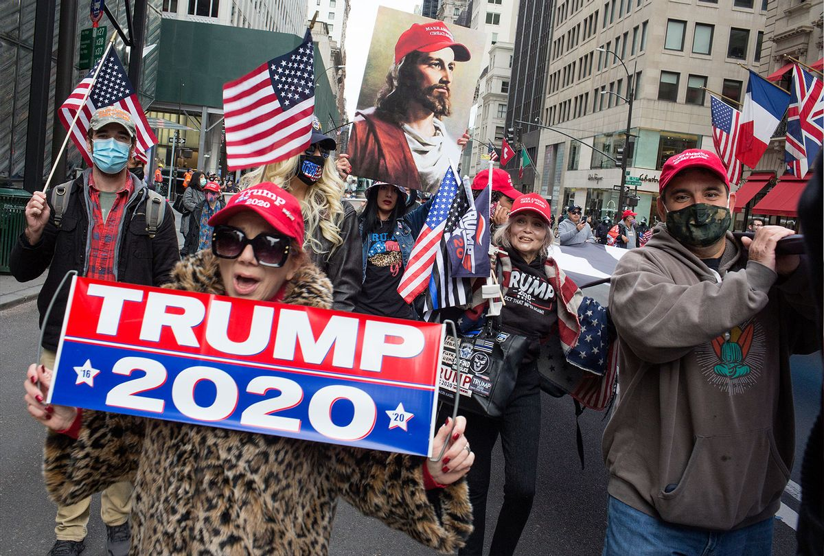 Trump supporters rally in front of Trump Tower and march down 5th Avenue on October 25, 2020 in New York City. As the Presidential election approaches, Trump supporters are becoming more visible, with frequent rallies and caravans. (Andrew Lichtenstein/Corbis via Getty Images)