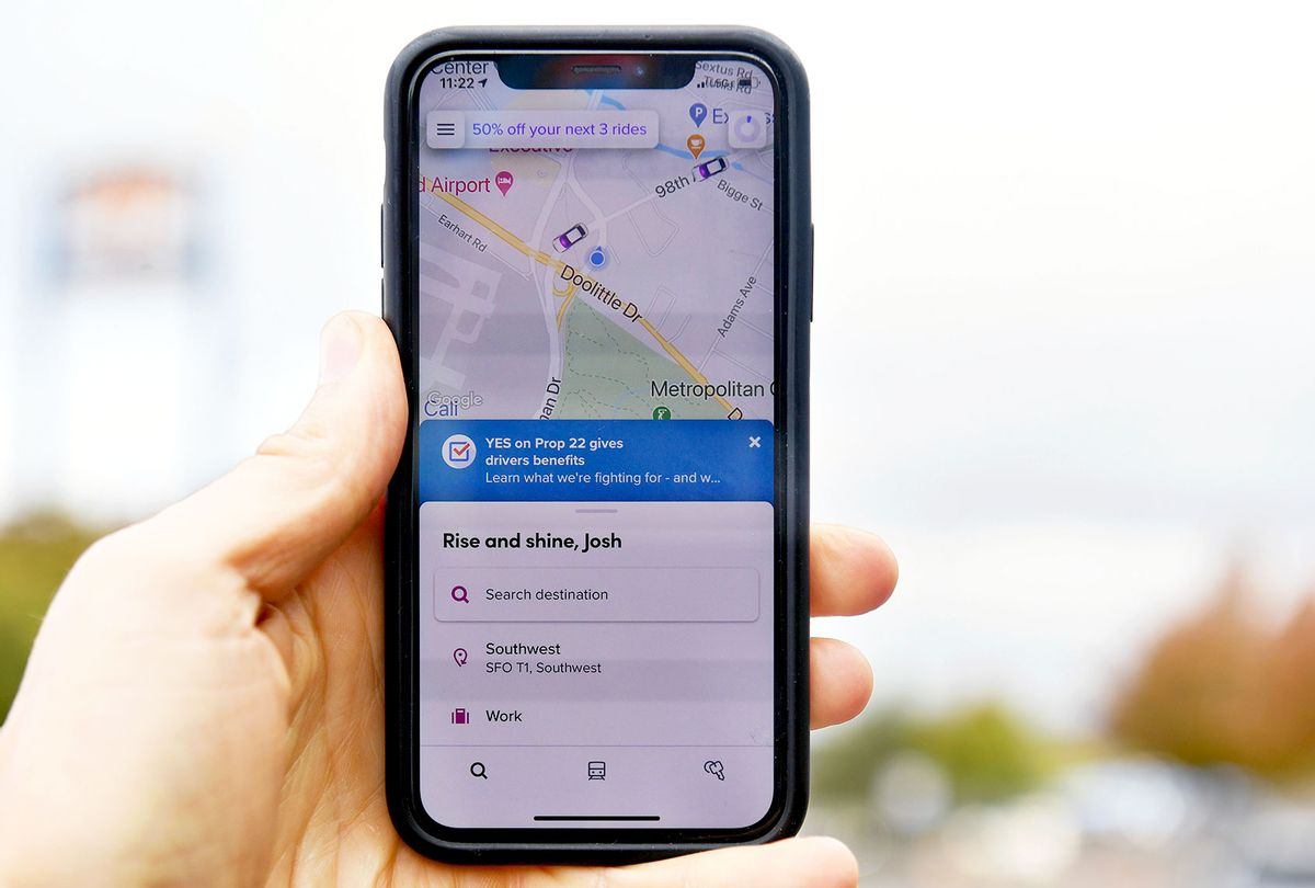 A smartphone's Lyft app displays a message motivating users to vote yes on Proposition 22 in Oakland, California on October 9, 2020. (JOSH EDELSON/AFP via Getty Images)