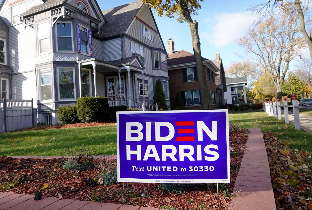 A campaign sign supporting Democratic presidential nominee Joe Biden and his running mate Sen. Kamala Harris (D-CA) sits in the front yard of a home on November 01, 2020 in Racine, Wisconsin. Today is the final day for early voting in Wisconsin, a state which President Donald Trump won with less than 1 percent of the vote in 2016. (Scott Olson/Getty Images)