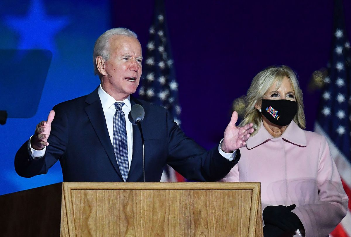 Democratic presidential nominee Joe Biden along with his wife Jill Biden speaks during election night at the Chase Center in Wilmington, Delaware, early on November 4, 2020. (ANGELA WEISS/AFP via Getty Images)