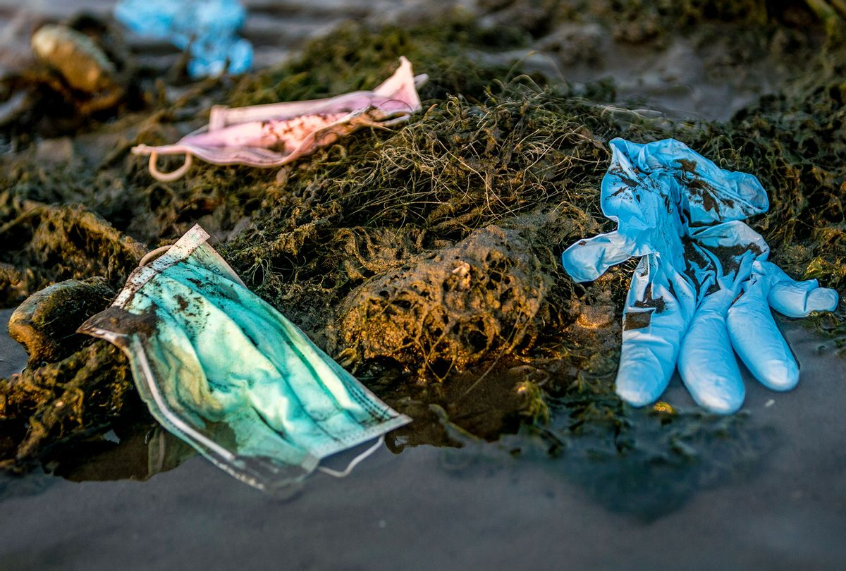 Discarded used disposable medical mask floats in sea waters (Getty Images)