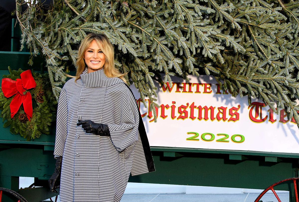 US First Lady Melania Trump receives the White House Christmas Tree at the White House in Washington, DC, on November 23, 2020. (NICHOLAS KAMM/AFP via Getty Images)