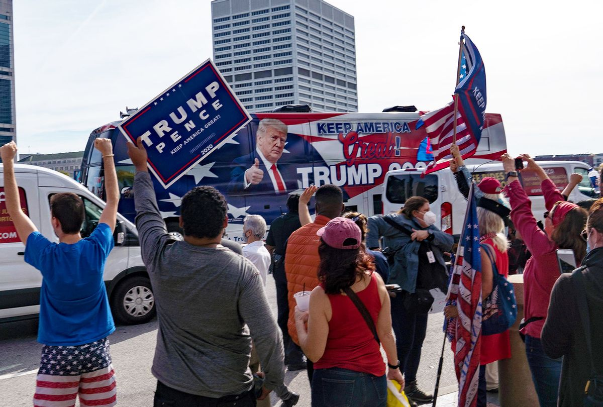 A Trump Bus drives by supporters of President Donald Trump protest outside State Farm Arena as ballots continue to be counted inside on November 5, 2020 in Atlanta, Georgia. Attention is focused on a few key battleground states as the U.S. presidential election remains too close to call. (Megan Varner/Getty Images)