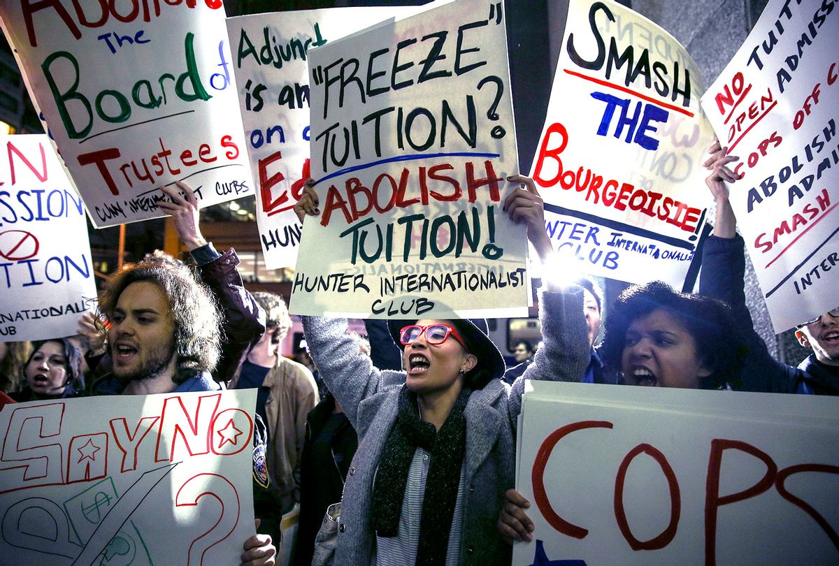Students hold placards as they stage a demonstration at the Hunter College, which is a part of New York City University, to protest ballooning student loan debt for higher education and rally for tuition-free public colleges in New York on November 13, 2015. (Cem Ozdel/Anadolu Agency/Getty Images)