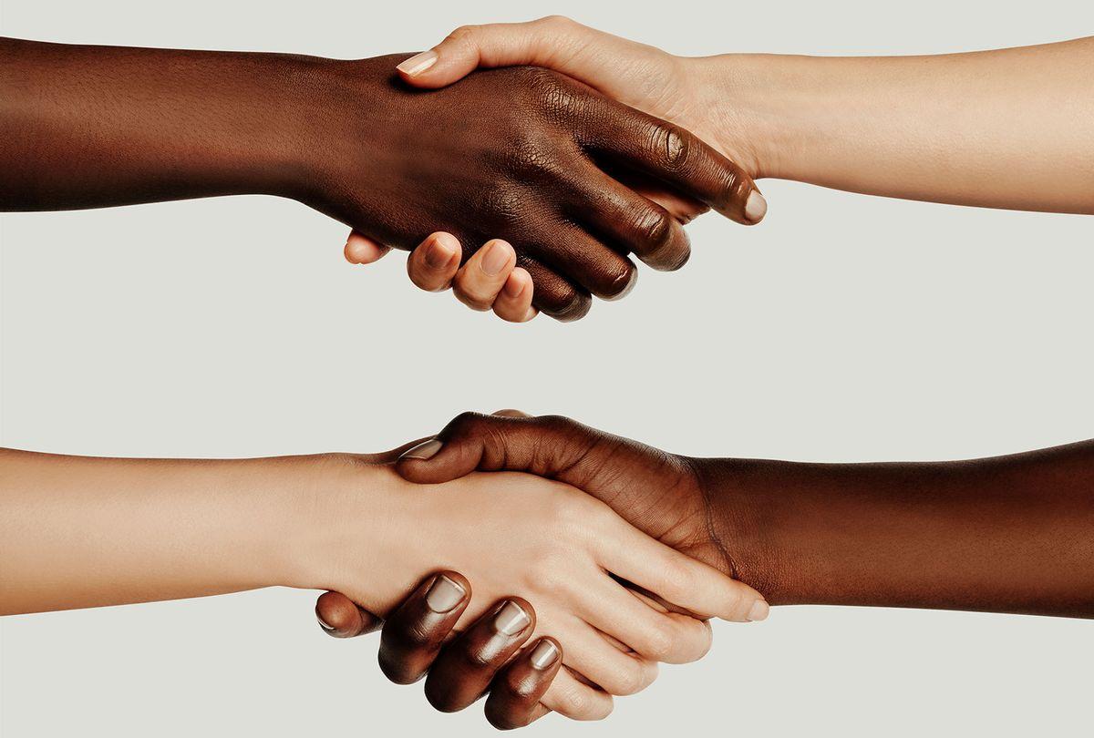 Interracial Handshake (Getty Images)