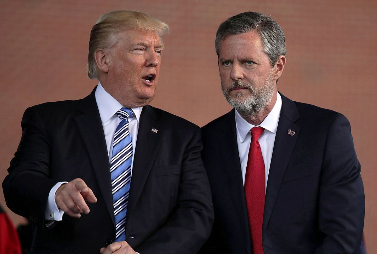President Donald Trump (L) and Jerry Falwell (R), President of Liberty University, on stage during a commencement at Liberty University May 13, 2017 in Lynchburg, Virginia. President Trump is the first sitting president to speak at Liberty's commencement since George H.W. Bush spoke in 1990. (Alex Wong/Getty Images)