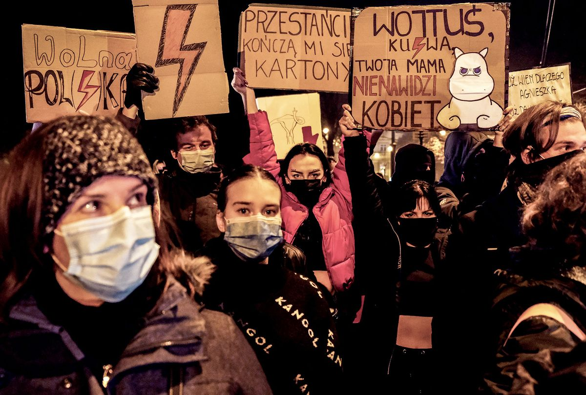 Protesters hold banners and shout slogans during the 12th day of protests against the Constitutional Court ruling on tightening the abortion law in front of the Archbishops Palace on November 02, 2020 in Krakow, Poland. The country's constitutional tribunal recently ruled that terminating pregnancies due to serious, irreversible fetal defects is unconstitutional. The decision sparked a wave of protests against the ruling Law and Justice party (PiS). (Omar Marques/Getty Images)