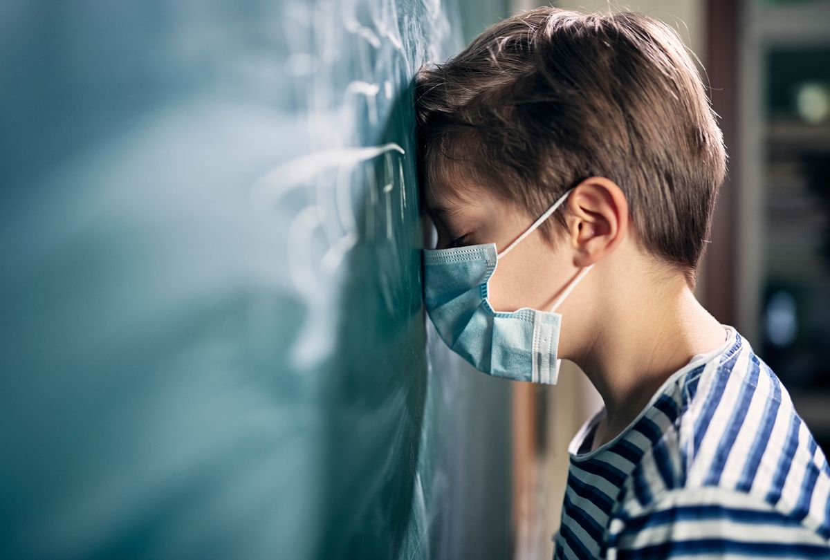 Little boy overwhelmed during the COVID-19 pandemic (Getty Images)