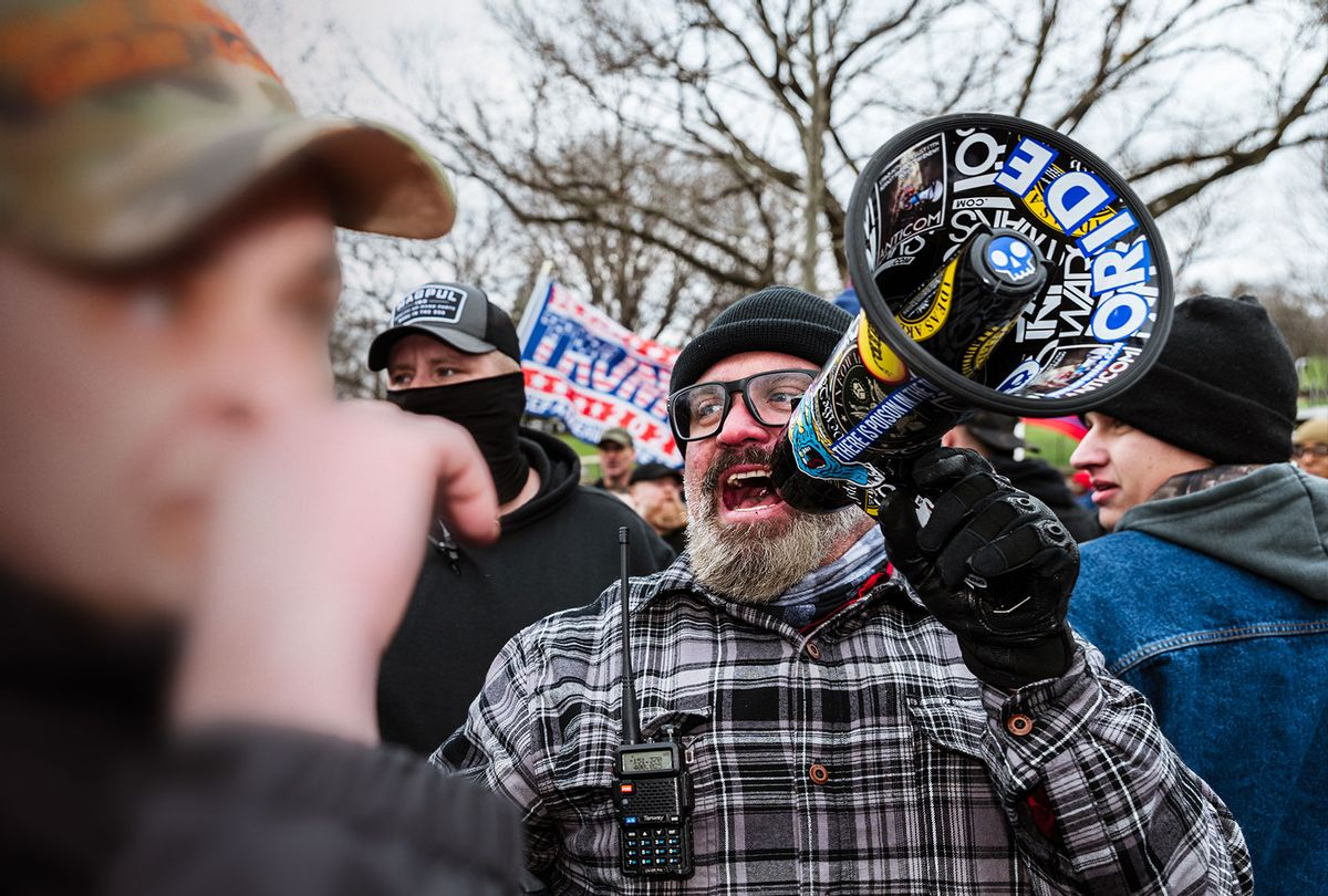 Pro-Trump protesters and Proud Boys march in front of the Capitol Building on January 6, 2021 in Washington, DC. (Jon Cherry/Getty Images)