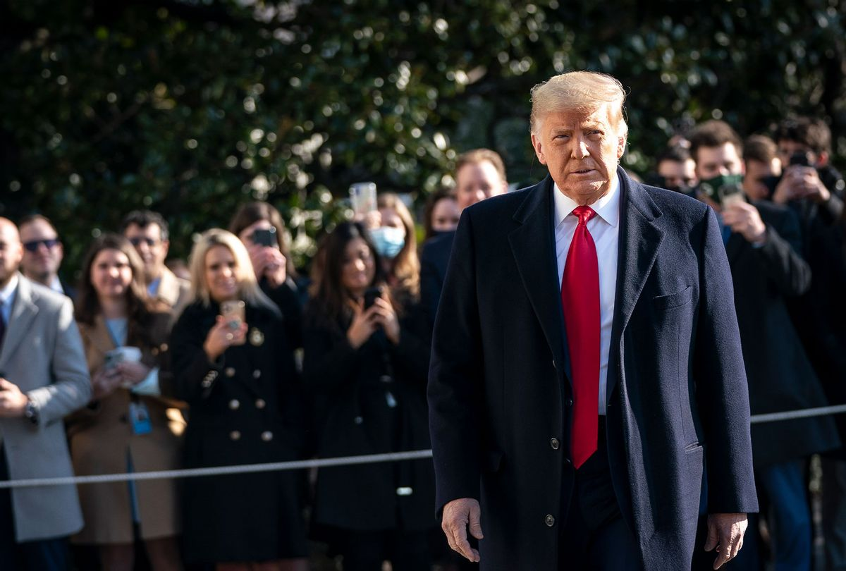 U.S. President Donald Trump turns to reporters as he exits the White House to walk toward Marine One on the South Lawn on January 12, 2021 in Washington, DC. (Drew Angerer/Getty Images)