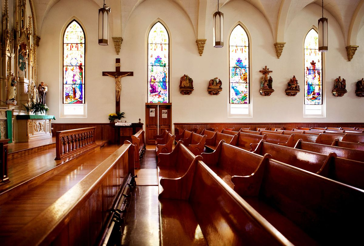 Empty pews and stained glass windows in church (Getty Images)