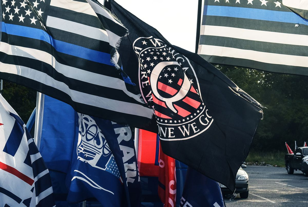 A flag for the QAnon conspiracy theory is flown with other right wing flags during a pro-Trump rally on October 11, 2020 in Ronkonkoma, New York. (Stephanie Keith/Getty Images)