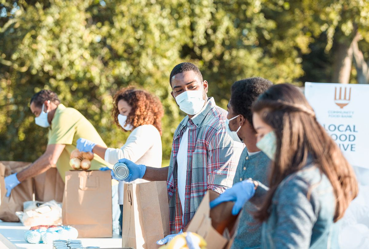 Community food bank volunteers working during COVID-19 crisis (Getty Images)